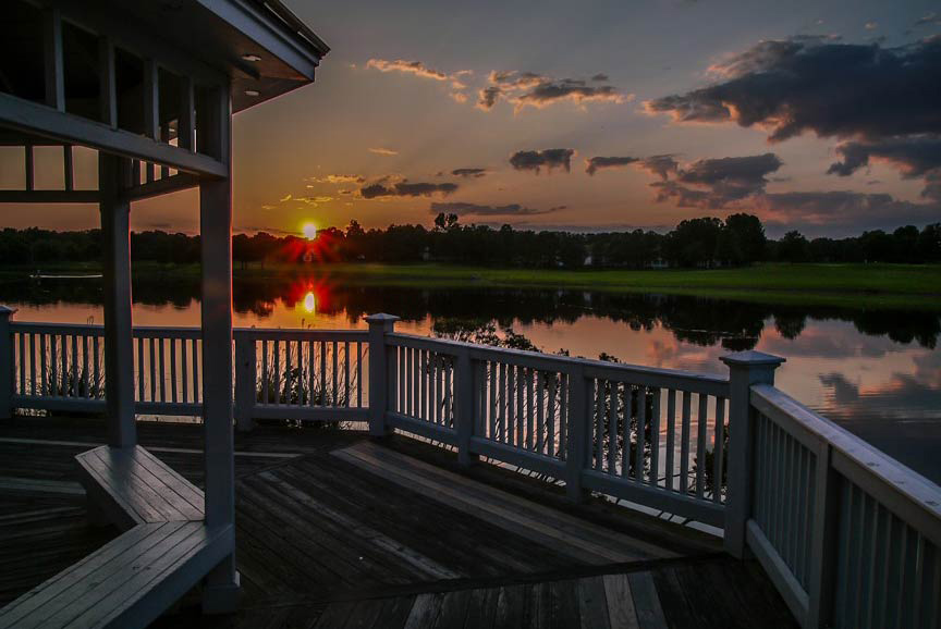 The Wyndham gazebo at night with the sun setting over the lake - Glen Allen, VA