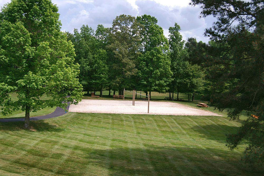 Sand volleyball court surrounded by a beautiful grass field in wyndham - glen allen, va